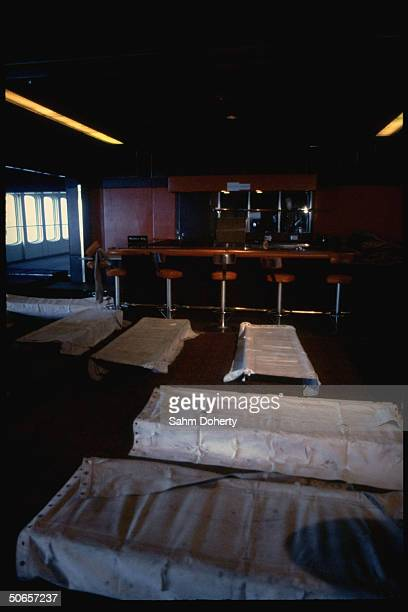 Bar room fitted w. Cots on floor to accommodate soldiers en route to Falklands, on QE2
