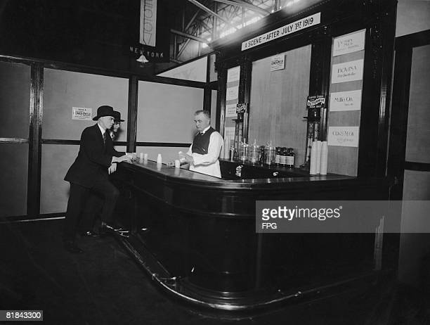 A bar serving nonalcoholic milkbased cocktails at the National Dairy Show New York 1919 A sign above the bar reads 'A Scene After July 1st 1919' the...