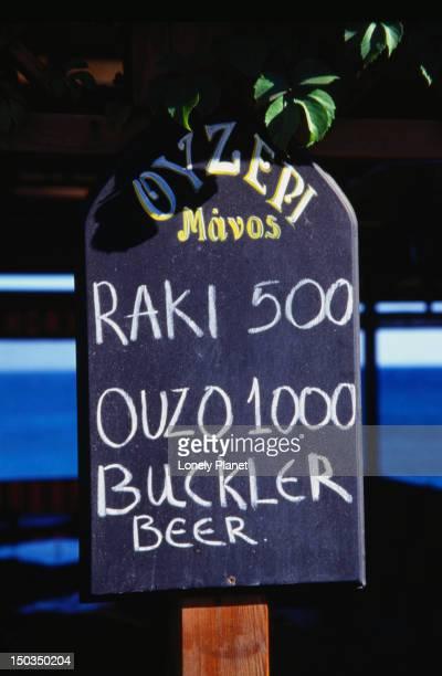 Bar sign advertising Ouzo, Raki and Buckler Beer - Hania, Hania Province, Crete
