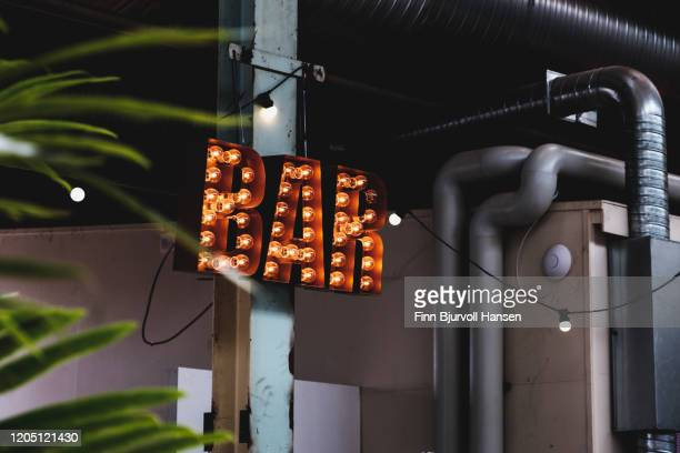 bar sign with light bulbs - finn bjurvoll ストックフォトと画像
