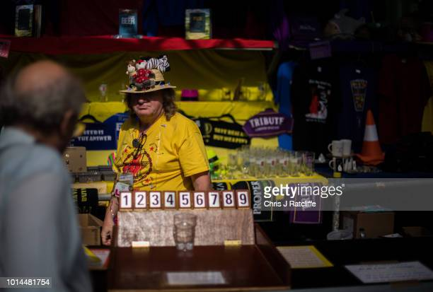 Bar staff serve customers during the Great British Beer Festival at Olympia Exhibition Centre on August 10 2018 in London England The five day...