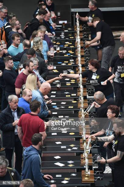Bar staff serve visitors at the CAMRA Great British Beer festival at Olympia exhibition centre on August 8, 2017 in London, England. The five day...
