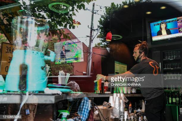 Bar tender Jake Glazier serves his customers at an open roadside bar in Atlanta Georgia on April 23 2020 The US state of Georgia takes a massive...