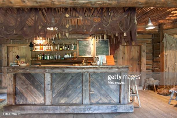 bar with a rustic decor - estland bildbanksfoton och bilder