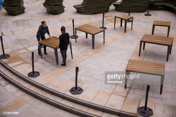 Bar workers set up table places outside a public house in the City of London, U.K., on Monday, Oct. 12, 2020. The approach of Brexit has London...