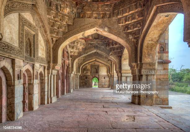 bara gumbad and mosque facades lodi gardens or lodhi gardens mausoleums in new delhi, india. - ancient stock pictures, royalty-free photos & images