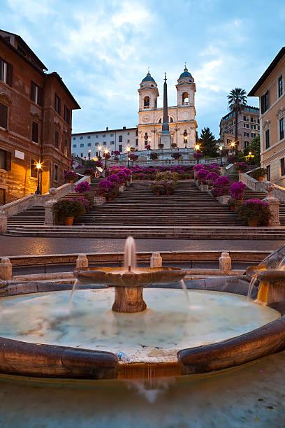 Baraccia fountain at bottom of Spanish Steps at Piazza di Spagna below Trinita dei Monti Church.