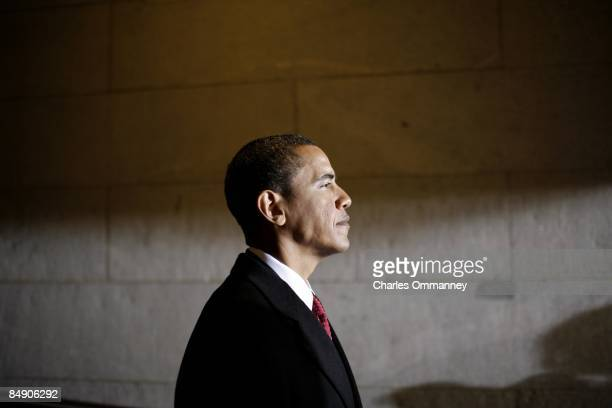 Barack H Obama holds in a crowded hallway backstage at the Capital moments before walking out to be sworn in by Chief Justice John Roberts as the...