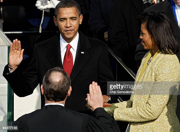 Barack H. Obama is sworn in by Chief Justice John Roberts as the 44th president of the United Statesas on the West Front of the Capitol as his wife...