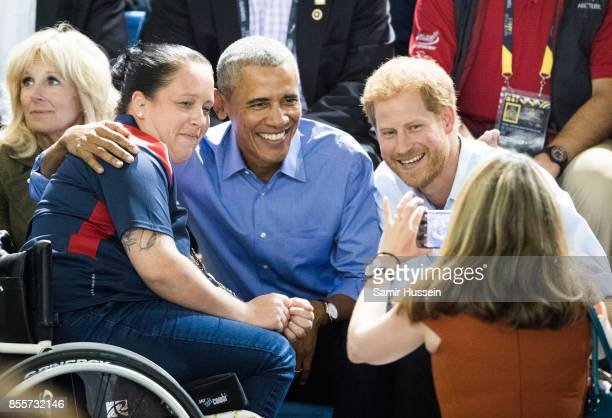 Barack Obama and Prince Harry pose for a photo as thery watch the wheelchair basketball on day 7 of the Invictus Games Toronto 2017 on September 29...
