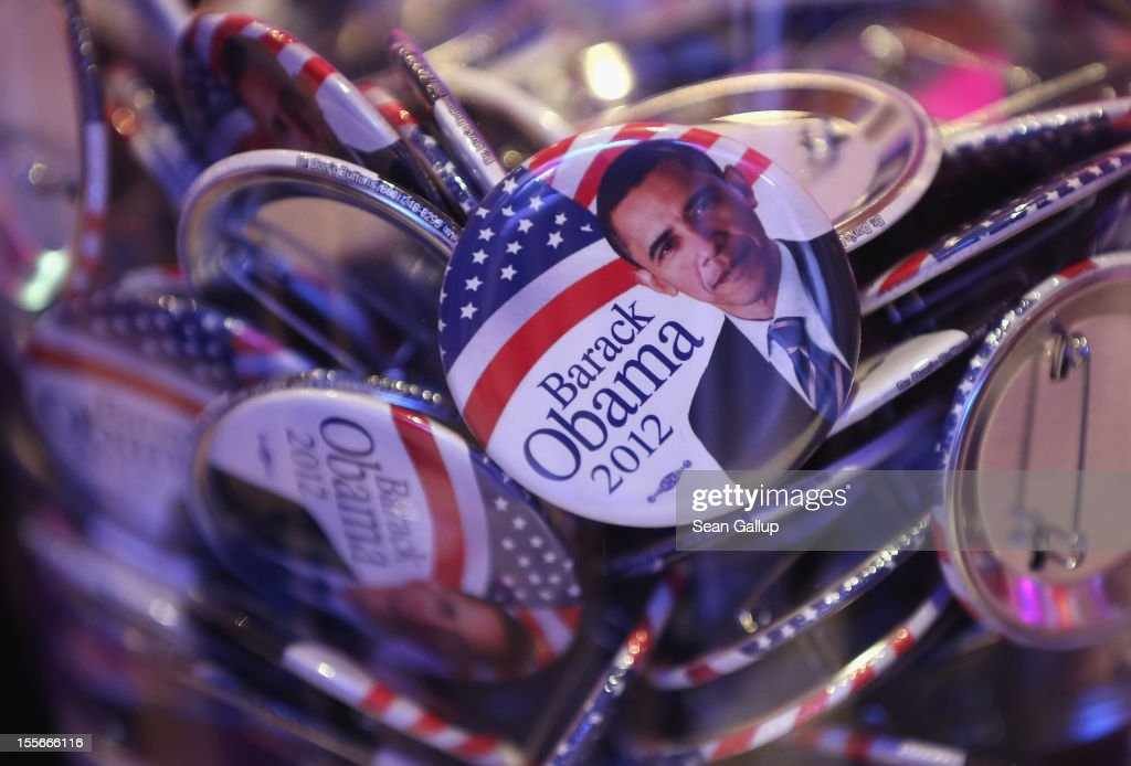 Barack Obama buttons lie in a glass jar at a U.S. election party at the Bertelsmann Foundation on November 6, 2012 in Berlin, Germany. Polls suggest today's voting in American presidential elections will create a neck and neck race between incumbent Democrat President Barack Obama and his opponent, Republican Mitt Romney.