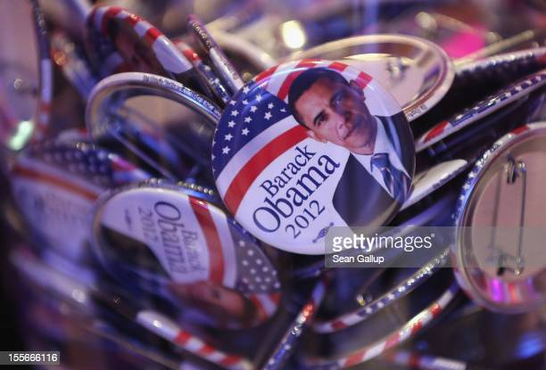 Barack Obama buttons lie in a glass jar at a US election party at the Bertelsmann Foundation on November 6 2012 in Berlin Germany Polls suggest...