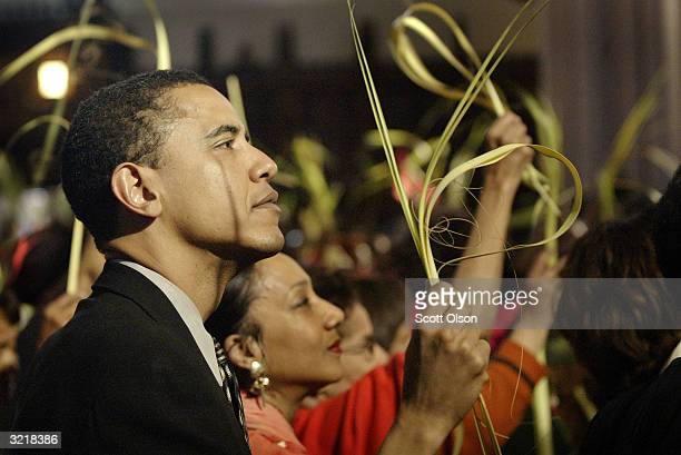 Barack Obama Democratic candidate for the US Senate in Illinois attends Palm Sunday mass at St Sabina's church where Archbishop Desmond Tutu was...