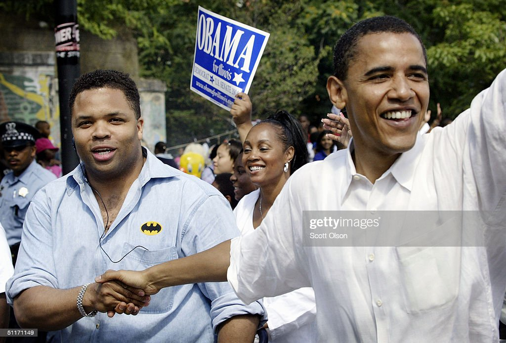 Barack Obama (R), Democratic candidate for U.S. Senate from Illinois, campaigns with U.S. Rep. Jesse Jackson Jr. (D-IL) during the Bud Billiken parade August 14, 2004 on the South Side of Chicago, Illinois. Obama marched the parade route with his wife Michelle and several hundred supporters.