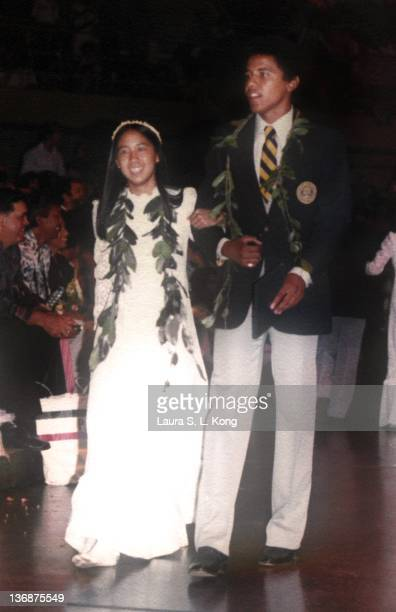 Barack Obama escorts Laura Kong during the graduation ceremony at Punahou School in May 1979 in Honolulu Hawaii