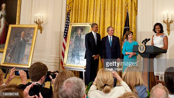 Barack Obama George W Bush Laura Bush and Michelle Obama attend the George W Bush and Laura Bush Portrait unveiling at the White House on May 31 2012...