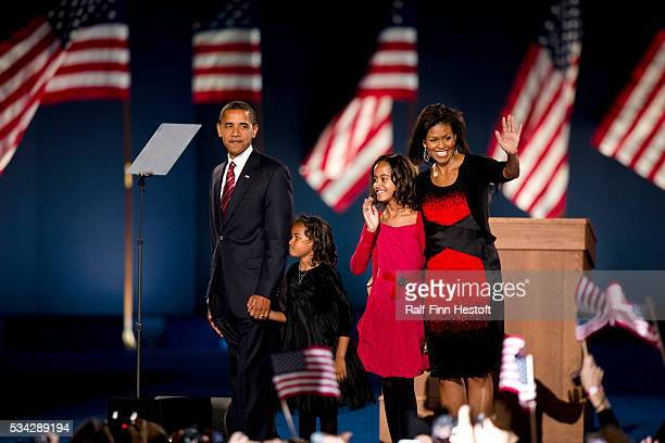 Barack Obama, his wife Michele and daughters Sasha and Malia are introduced to the crowd of supporters in Chicago's Grant Park as the new first...