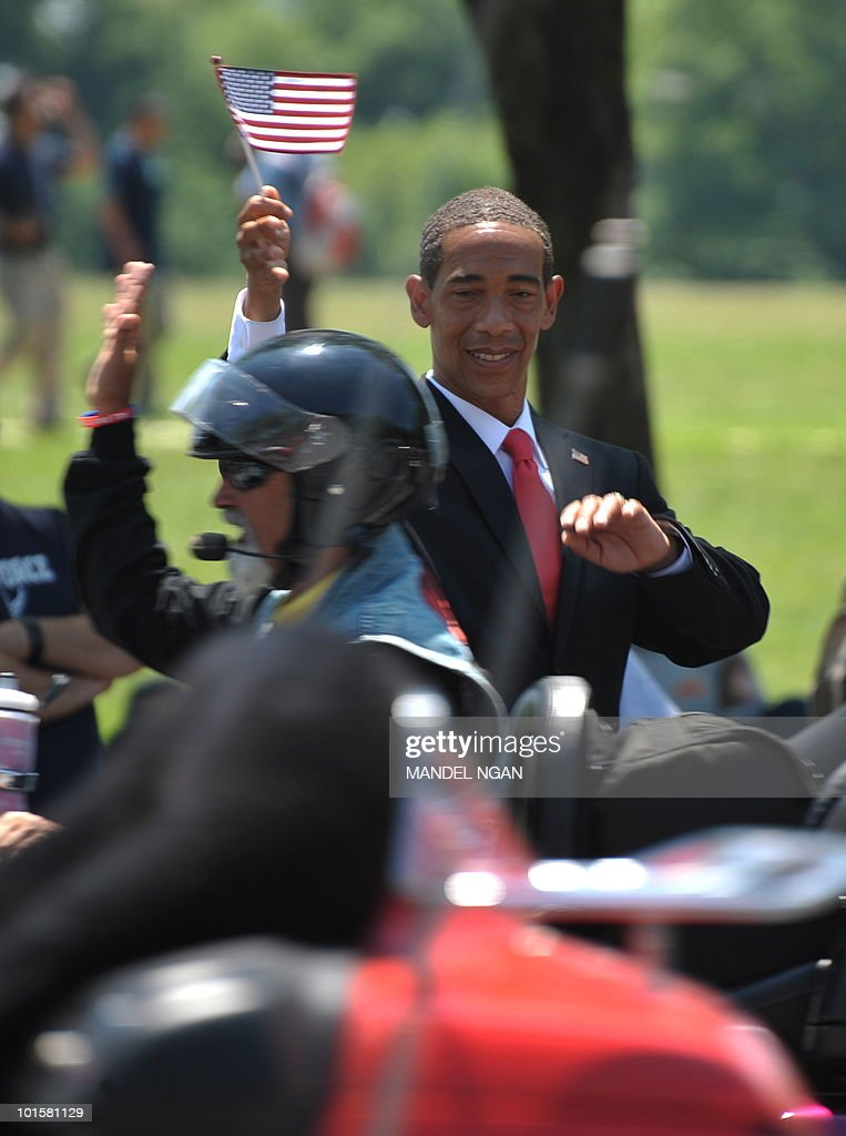 A Barack Obama look-alike greets motorcyclists taking part in the Rolling Thunder demonstration as they ride from the Pentagon to the Vietnam Veterans Memorial on May 30, 2010 in Washington. The event is to draw attention to the issue of prisoners of war and those who are missing in action. AFP PHOTO/Mandel NGAN