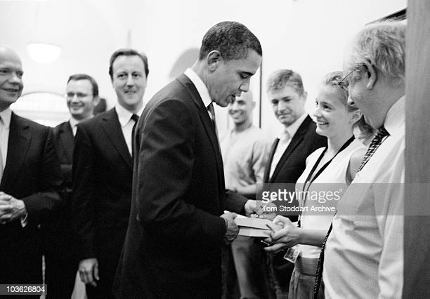 Barack Obama signs his autobiography and charms office staff after holding private talks with Conservative Leader David Cameron when the US...