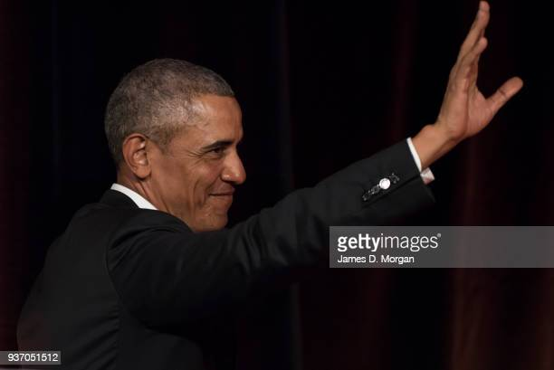 Barack Obama waves goodbye to the audience as he attends a talk at the Art Gallery Of NSW on March 23 2018 in Sydney Australia The former US...