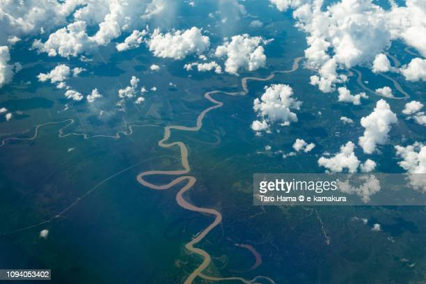 Baram River in Sarawak on the island of Borneo in Malaysia daytime aerial view from airplane