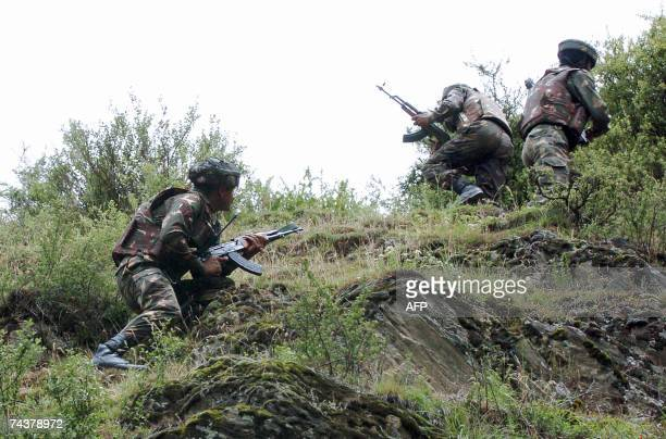 Indian troops conduct a search operation in woods along a road in the northern Baramulla district of Indianadministered Kashmir some 56 kms north of...