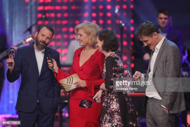 Baran bo Odar chats with host Annette Gerlach Jantje Friese and Oliver Masucci on stage during the 54th Grimme Award on April 13 2018 in Marl Germany