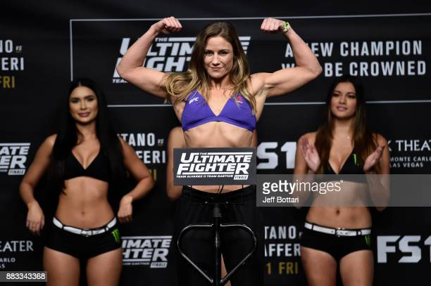 Barb Honchak poses on the scale during the TUF Finale weighin inside Park Theater on November 30 2017 in Las Vegas Nevada