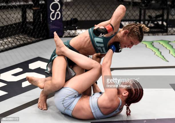 Barb Honchak punches Gillian Robertson during the filming of The Ultimate Fighter A New World Champion at the UFC TUF Gym on July 31 2017 in Las...