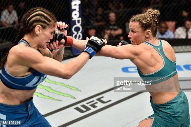 Barb Honchak punches Lauren Murphy in their women's flyweight bout during the TUF Finale event inside Park Theater on December 01 2017 in Las Vegas...