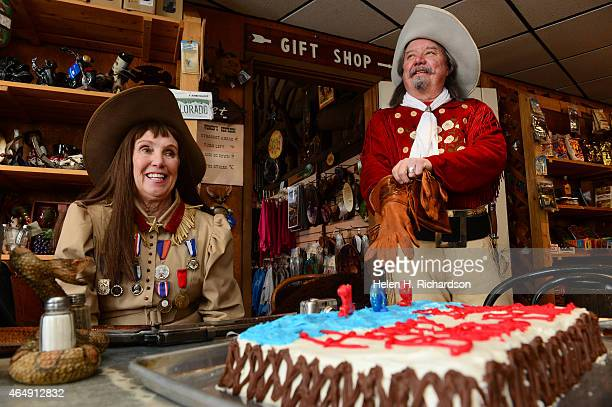Barb Melfi left and her husband Ralph right who are Colorado's official Buffalo Bill and Annie Oakley celebrate the western legend's 169th birthday...