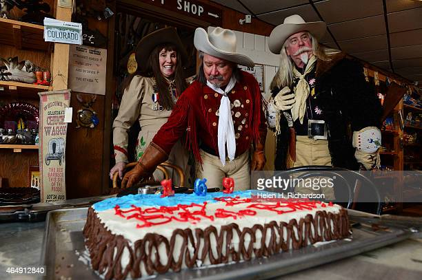 Barb Melfi left her husband Ralph middle who are Colorado's official Buffalo Bill and Annie Oakley and Gunny Jeff Norman right celebrate the western...