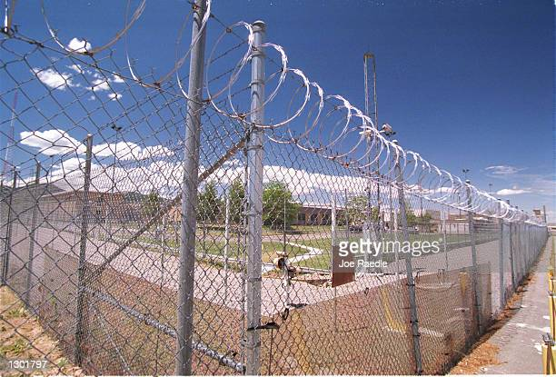 A barb wired fence lines the Plutonium Facility one of the most heavily guarded facilities June 14 2000 at the Los Alamos National Laboratory in Los...