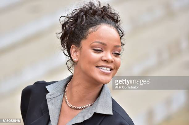 Barbadian musician and Global Ambassador for the Global Partnership for Education Rihanna smiles as she leaves the Elysee Palace in Paris on July 26...