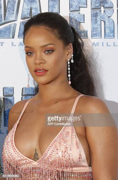 Barbadian singer and actress Rihanna poses for a photograph upon arrival for the prepremiere of the film Valerian and The City of a Thousand Planets...
