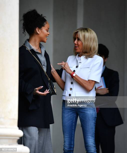 Barbadian singer and Global Ambassador for the Global Partnership for Education Rihanna is welcomed by Brigitte Macron the wife of French President...