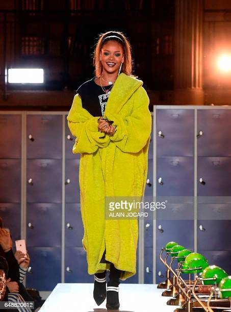 Barbadian singer Rihanna acknowledges the audience following Rihanna's Fenty Collection from PUMA women's FallWinter 20172018 readytowear collection...