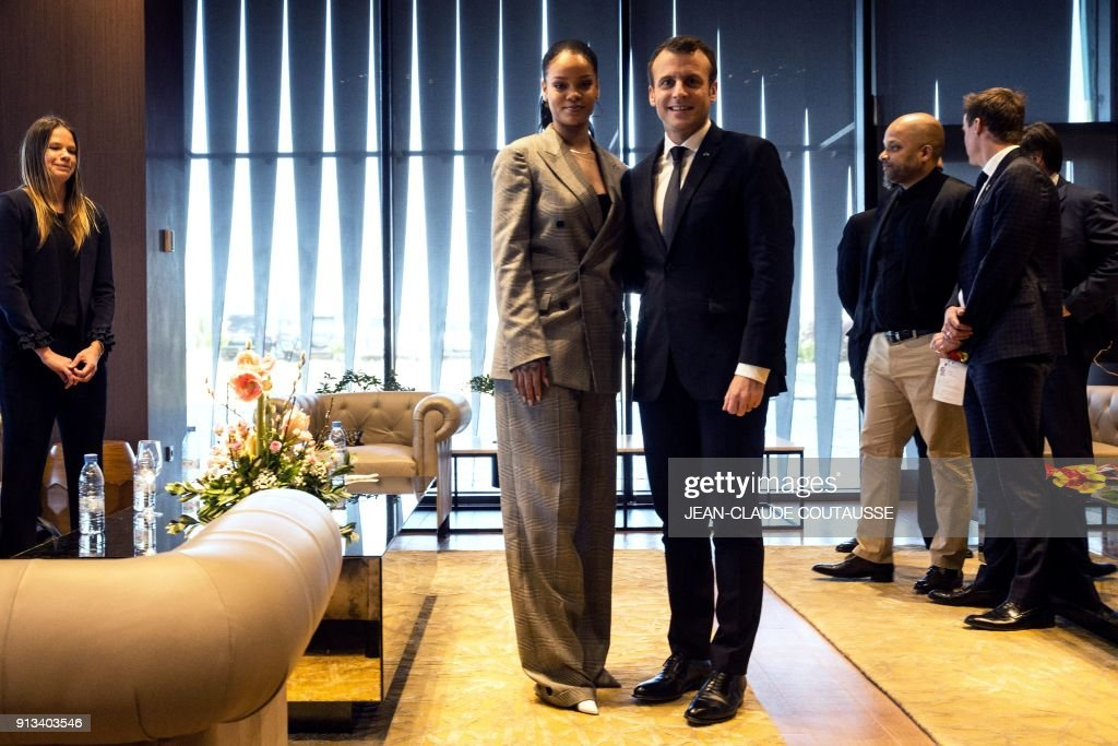 TOPSHOT - Barbadian singer Rihanna (L) and French President Emmanuel Macron pose a they attend the conference 'GPE Financing Conference, an Investment in the Future' organised by the Global Partnership for Education in Dakar on February 2, 2018, as part of Macron's visit to Senegal. Macron and the Senegalese president are co-hosting a conference organised by the Global Partnership for Education, aimed at pressuring donors to finance the education of a quarter of a billion children worldwide who are currently out of school, while Rihanna is attending as a global ambassador for the organisation. PHOTO / POOL / Jean-Claude Coutausse