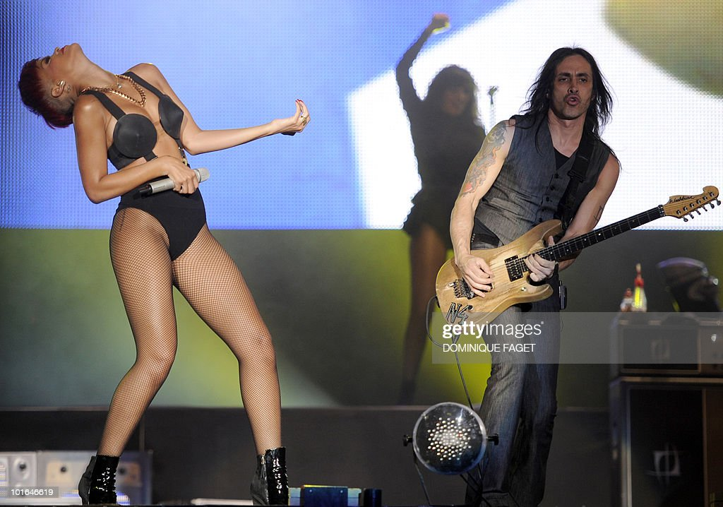 Barbadian singer Rihanna (L) performs on stage during the 'Rock in Rio' music festival on June 5, 2010 in Arganda del Rey near Madrid.