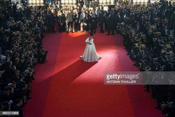 TOPSHOT Barbadian singer Rihanna poses as she arrives on May 19 2017 for the screening of the film 'Okja' at the 70th edition of the Cannes Film...