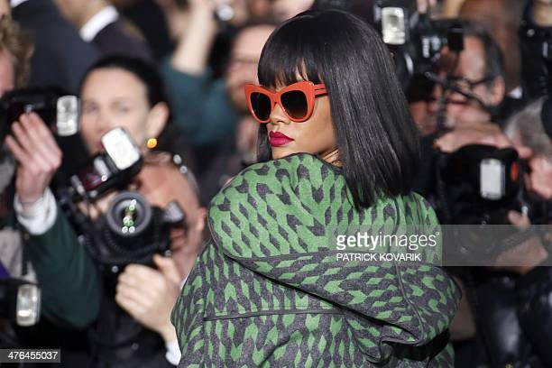 Barbadian singer Rihanna poses as she arrives to attend Stella McCartney 2014/2015 Autumn/Winter readytowear collection fashion show on March 3 2014...