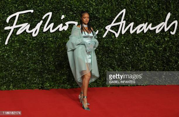 Barbadian singer Rihanna poses on the red carpet upon arrival at The Fashion Awards 2019 in London on December 2 2019 The Fashion Awards are an...