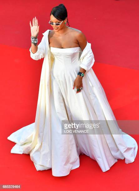 Barbadian singer Rihanna waves as she arrives on May 19 2017 for the screening of the film 'Okja' at the 70th edition of the Cannes Film Festival in...