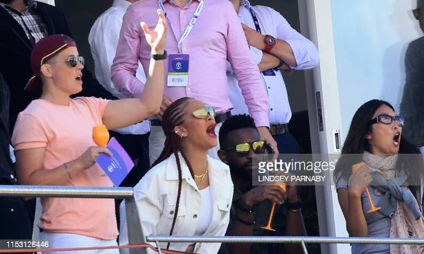 TOPSHOT Barbadian singer/actress Rihanna spectates during the 2019 Cricket World Cup group stage match between Sri Lanka and West Indies at the...