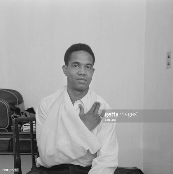 Barbados born cricketer, and captain of the West Indies cricket team, Garfield Sobers pictured with his arm in a sling following an injury, 23rd July...