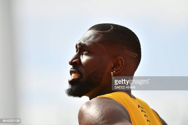 Barbados' Burkheart Ellis smiles after he competed in the athletics men's 200m heats during the 2018 Gold Coast Commonwealth Games at the Carrara...