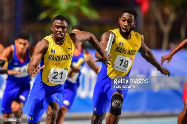 Barbados' Joaqone Oite and Ellis Burkheart compete in the Men's 4x100m relay final during the 2018 Central American and Caribbean Games in...