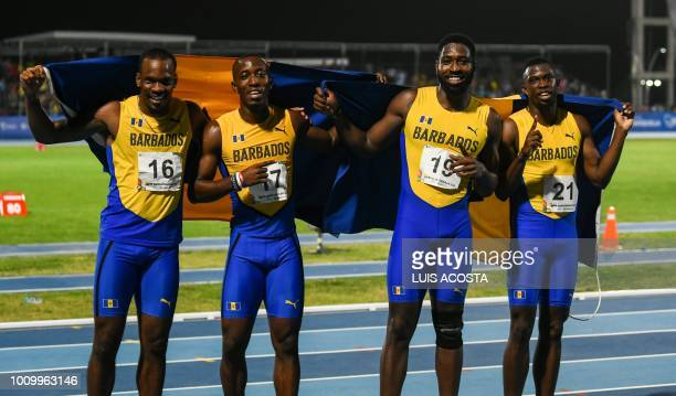 Barbados' Shane Brathwite Mario Burke Ellis Burkheart and Joaqone Oite pose after winning the Men's 4x100m relay final during the 2018 Central...