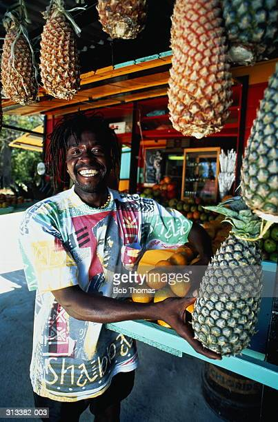 Barbados,St Peter,native man at his tropical fruit stall,smiling