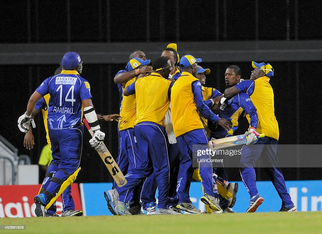 Barbados Tridents teammates hug Akeal Hosein (2R) for winning a match between Barbados Tridents and Antigua Hawksbills as part of the week 3 of Caribbean Premier League 2014 at Kensington Oval on July 25, 2014 in Bridgetown, Barbados.